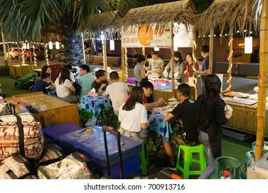 Ratchada, Bangkok, 21 AUG 2017: Tourists enjoy dinner at Suan Lum Ratchada night market in Bangkok