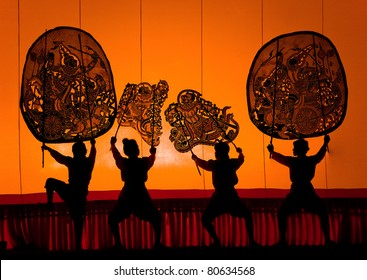 RATCHBURI, THAILAND - APRIL 13: Large Shadow Play is performed at Wat Khanon on April 13, 2011. The ancient performing art involves manipulating puppets of cowhide in front of a backlit white screen