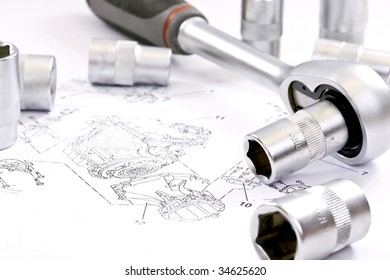Ratchet spanner and sockets on technical draw background