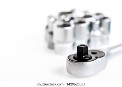Ratchet tool. Ratchet wrench. Universal socket set white background isolated. Crafts and repair. Knob for socket wrench nut ratchet close up. Steel made no skid threaded handle without slipping.
