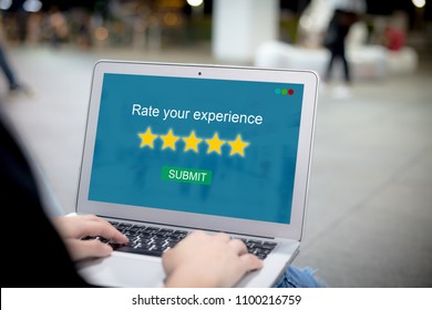 Rate your experience for customer survey concept.Female hands using laptop or pc
