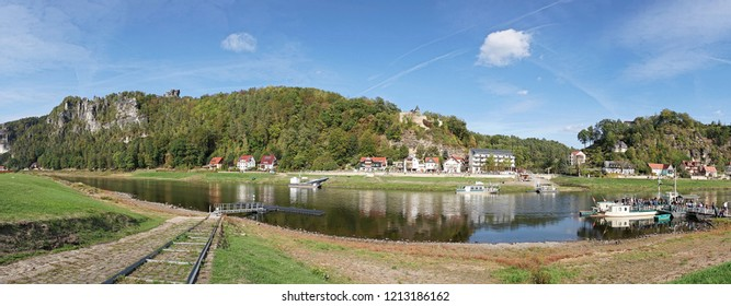RATHEN, GERMANY – OCTOBER 04, 2018: The river Elbe at Rathen in the Elbe Sandstone Mountains with tourists at the ferryboat