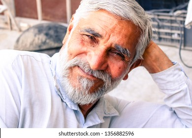 Ratia, Haryana, India - 23 March, 2019: smiley senior man with beard and moustache resting in home