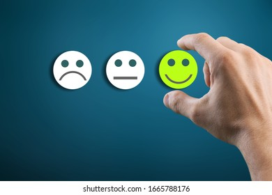 Rating concept. Woman hand choosing happy smile face emotion