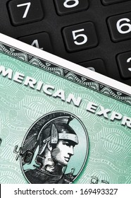 Ratingen, Germany - June 21, 2011: Closeup of green American Express credit card on a number pad. AMEX is one of the biggest credit card companies worldwide. Studio shot.