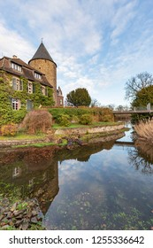 Ratingen - View to moated Castle Linnep where the Tower is reflected in the Moat of the Castle, North Rhine Westphalia, Germany, Ratingen, 11.12.2018