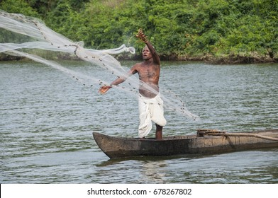 RATNAGIRI, MAHARASHTRA, INDIA 22 MARCH 2015 : Unidentified fisharman fishing with boat in river at his village, daily lifestyle in rural area in Maharashtra.