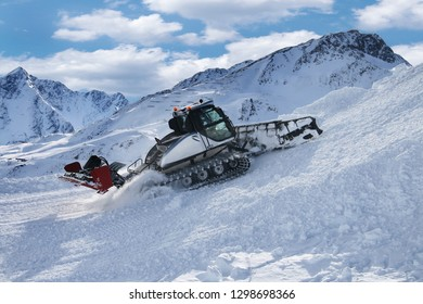 Ratrac snowcat machine on snow hill ready for skiing slope preparations in Austrian Alps.