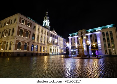 Ratslaukums square in Riga Old Town, Latvia at night. Buildings in Christmas decoration
