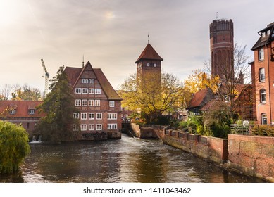 Ratsmuhle or old water mill and Wasserturm or water tower on Ilmenau river at morning in Luneburg. Germany