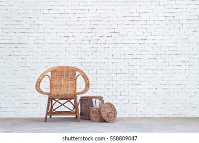 Rattan chair and furniture on concrete floor and white brick wall background, interior decoration concept