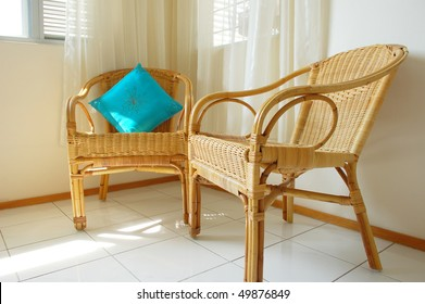 Rattan chairs in a living hall