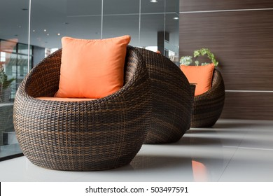 rattan chairs with pillows