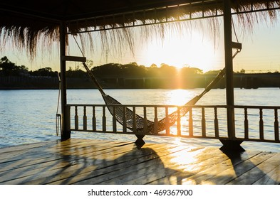rattan cradle in floating Home with fair sunlight at kanjanaburi.Thailand