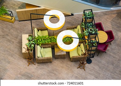 Rattan furniture used in the interior of a restaurant or cafe. Design of a cafeteria with large round lamps.