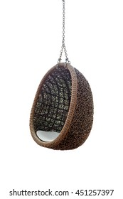 Rattan lounge hanging chair oval shape or egg shape with white pillow isolated on white background