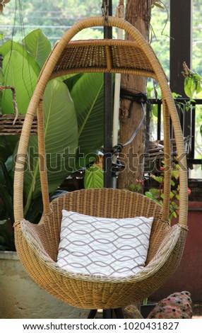Peachy Rattan Lounge Hanging Chair White Pillow Stock Image Machost Co Dining Chair Design Ideas Machostcouk