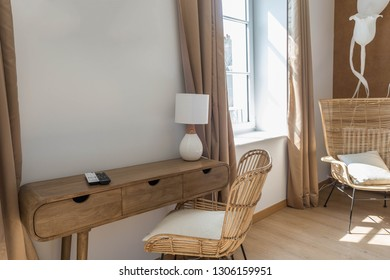 Rattan patio furniture against a white wall