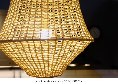 Rattan weave close-up. The green fabric lampshade at the magazine. colorful, decorative, electrical, furniture, illumination, lamp, lampshade, style, textile, abstract background, hanging lamp