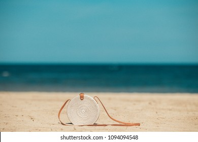Rattang bag on a tropical beach. Bali island. Organic material. Ecobag.