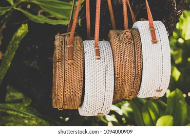 Rattang bags hanging on a tropical tree. Bali island. Organic material. Ecobag.