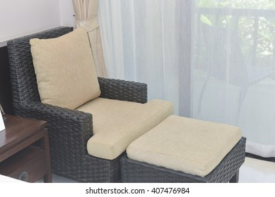 ratten chair in hotel room