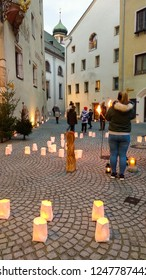 RATTENBERG, AUSTRIA - DECEMBER 1, 2018: The medieval town Rattenberg is bathed in the glow of starlight, candles, torchlight and bonfires at christmas time