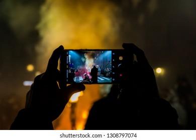 Rattenberg, Tyrol, Austria - 06.12.2018: Visitor recording the Krampus festivities