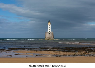 Rattray Head lighthouse, Aberdeenshire, Scotland with the beach and sea