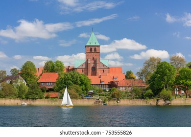 Ratzeburg with cathedral and other historic buildings at the shore of lake Ratzeburg in Schleswig-Holstein, Germany. With blue sky and clouds.