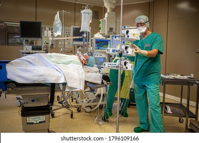 Ratzeburg, Germany - 8 13 2020: an anaesthesiologist in protective gear ventilating a Covid-19 patient in an operating room