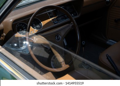 RATZEBURG, GERMANY - JUNE 2, 2019: Historic Ford Capry, interior and dashboard design in the classic automobil at the oldtimer car meeting in Ratzeburg, copy space, selected focus