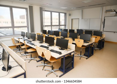 Ratzeburg, Germany, March 18, 2019: Computer classroom with monitors and keyboards for pupils and students in a school computer lab, selected focus, narrow depth of field