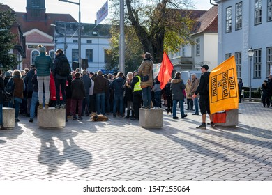"""Ratzeburg, Germany - Oktober 31, 2019. People demonstrate against racism. A flag carries the inscription """"kein Mensch ist illegal"""" means """"no human is illegal""""."""