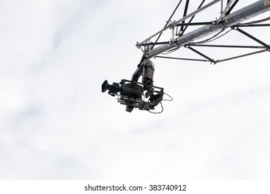 RAUBICHI, BELARUS - FEBRUARY 27, 2016:  Professional shooting with camera crane sporting event in Raubichi.