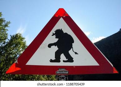 Rauma, Norway - August 15, 2018 - A traffic sign warning about Troll crossing at the beginning of the Trollstigen (Troll's Path) in Norway