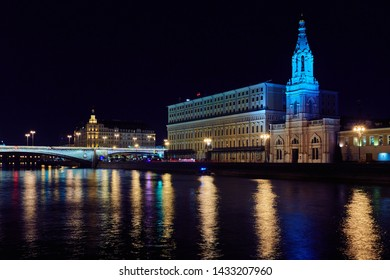 Raushskaya embankment in Moscow. Night illumination of the embankment of the river with beautiful reflection in the water. Moscow. Russia.