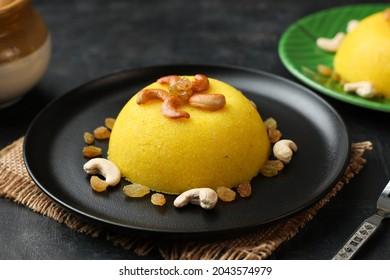 Rava kesari , Kesari bath , sheera or sujihalwa Indian sweet food.mithai for Diwali ,pongal, dussehra ugadi Karnataka, Tamil Nadu , south Indian , North Indian, Sri Lanka Semolina pudding dessert