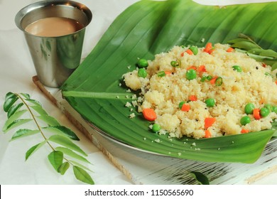 Rava Upma served in banana leaf with tea / South Indian vegan breakfast