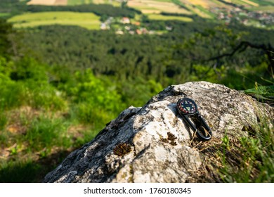 ravel concept photo of compass placed on the rock in Hohe Wand Nature Park. Lower Austria, June 2020.