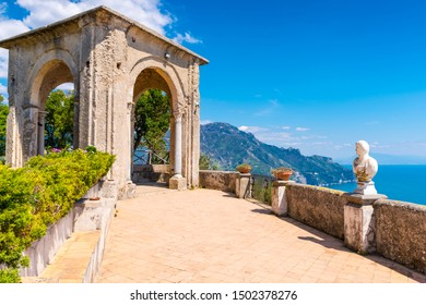 Ravello, Italy - April 19, 2019: Tourists at the Terrace of Infinity at the gardens of Villa Cimbrone, Ravello, Italy.