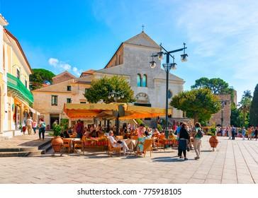 Ravello, Italy - October 2, 2017: People at street cafe on central square in Ravello village, Tyrrhenian sea, Amalfi coast, Italy