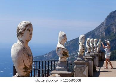 Ravello, Salerno / Italy - August 16 2018: Lady taking photograph on balcony of Villa Rufolo in Ravello, Salerno, Italy.