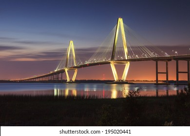 Ravenel Bridge in Charleston, South Carolina, illuminated against the night sky.