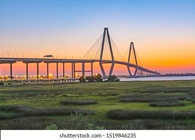 Ravenel Bridge at sunset. Panorama of Ravenel Bridge which crosses the Cooper River from Charleston, SC. Photo taken from Mount Pleasant, SC>