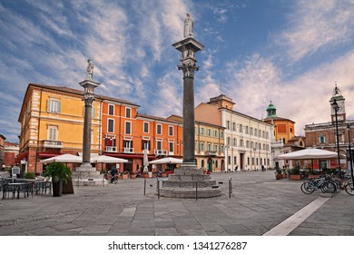 Ravenna, Emilia-Romagna, Italy: the main square Piazza del Popolo with the ancient buildings and the columns with the statues of Saint Apollinare and Saint Vitale