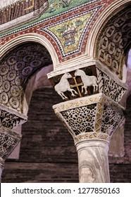 Ravenna, Italy - 01.12.2018: Early Christian Column capital with lambs and cross form San Vitale church. Lamb is christian symbol from early christianity.