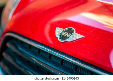 RAVENNA, ITALY - August 2, 2018: Dirt and dust cover the MINI COOPER logo on a car body