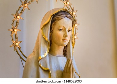 RAVENNA, ITALY - august 2, 2018: Statue of the Blessed Virgin Mary praying in  Church of Saint Mary of Suffrage in Ravenna