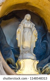 RAVENNA, ITALY - august 2, 2018: Statue of the Blessed Virgin Mary spreading arms in  Church of Saint Mary of Suffrage in Ravenna